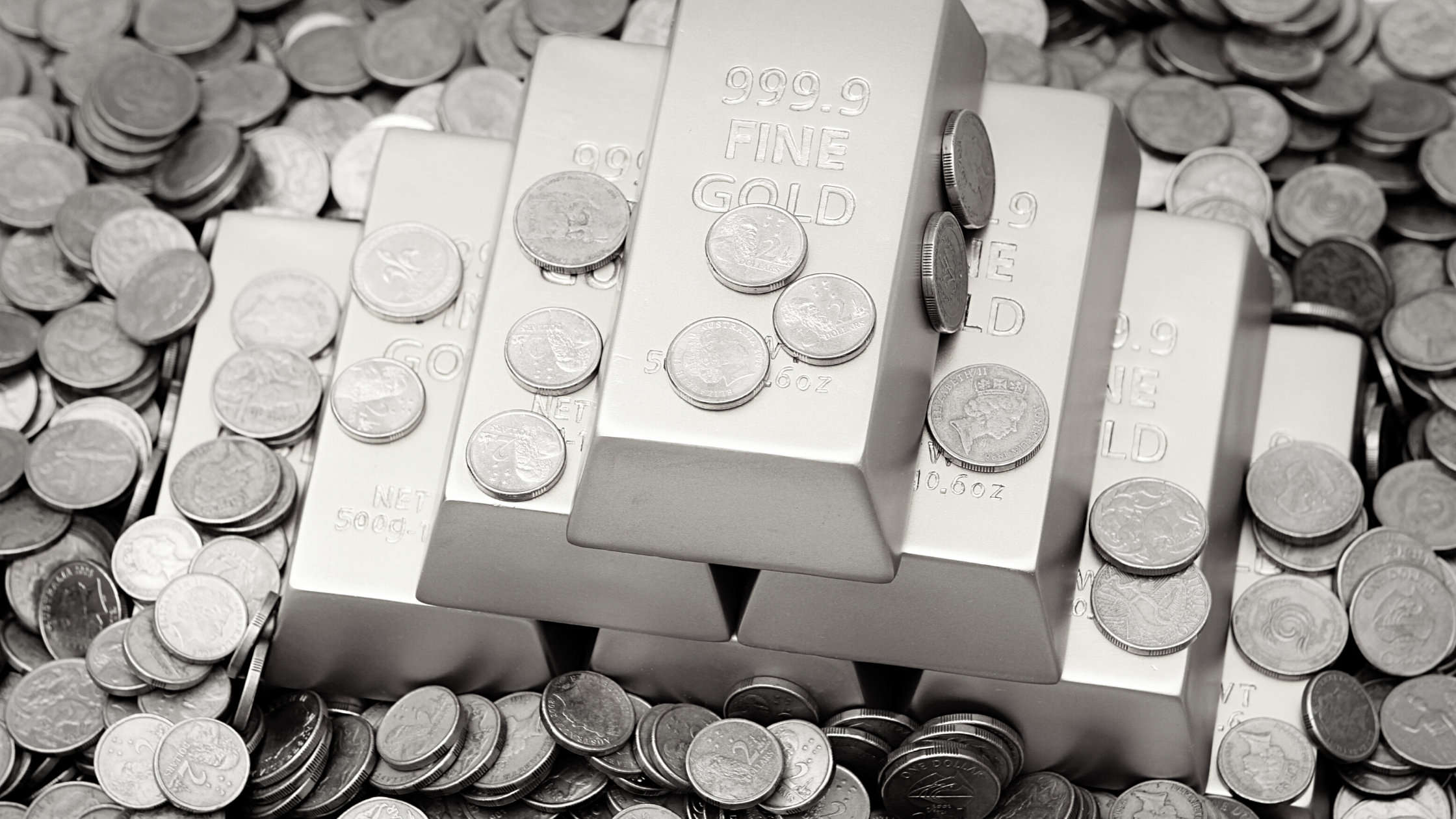 pile of gold bars and coins