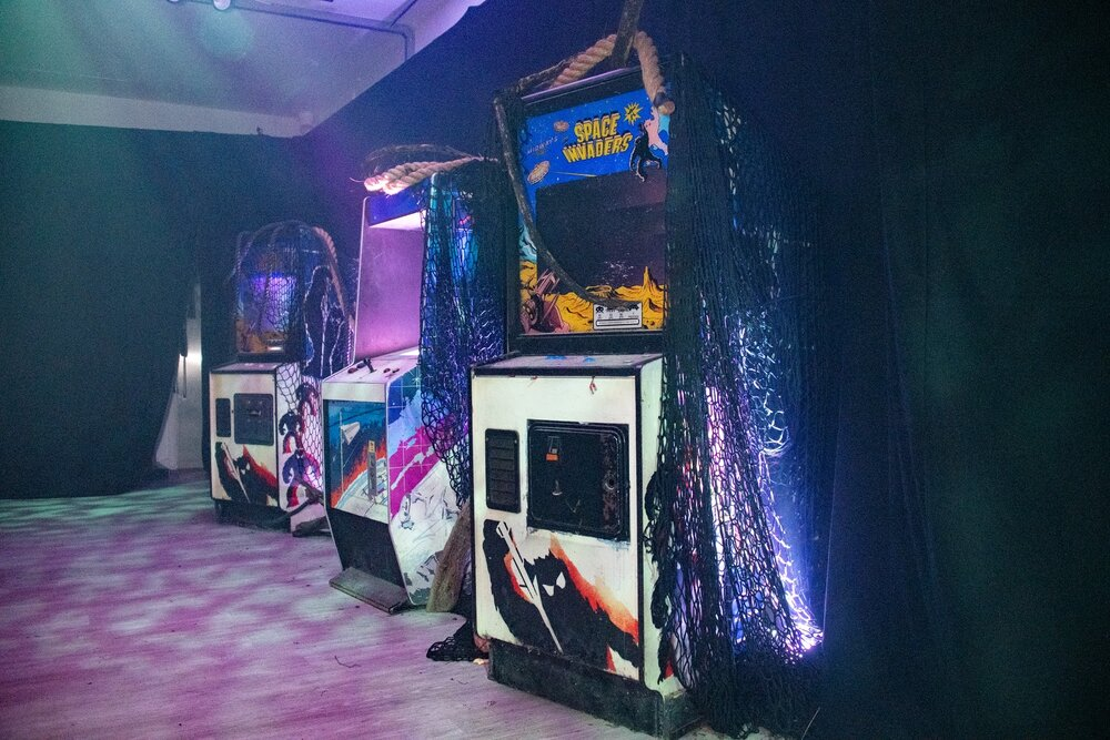 Retro arcade showing Space invaders and other arcade games