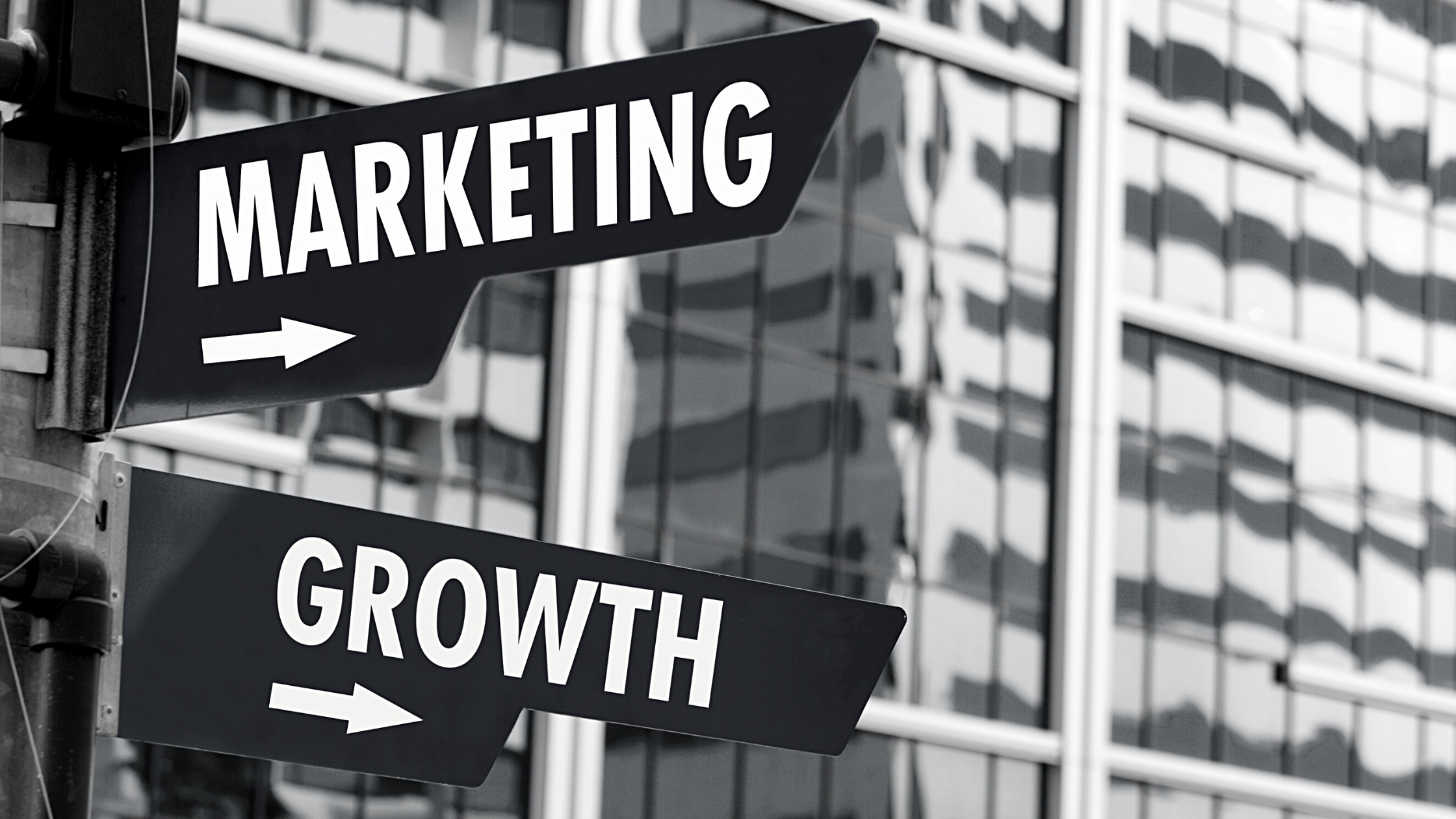 two street signs that say marketing and growth