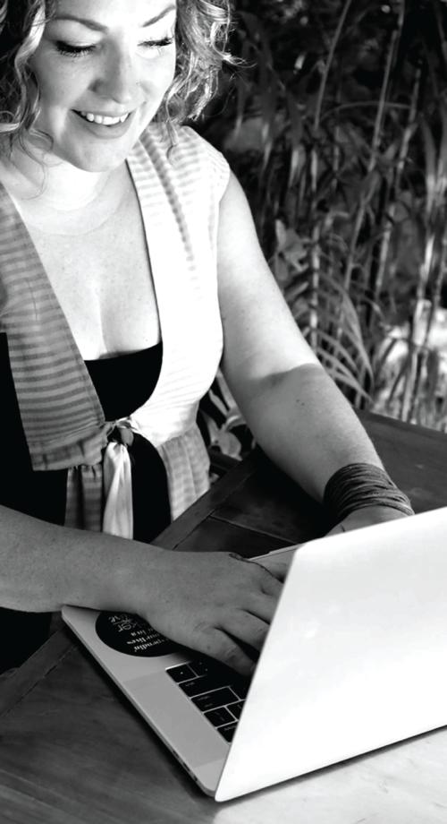 Jeanna Barrett working on inbound marketing on laptop